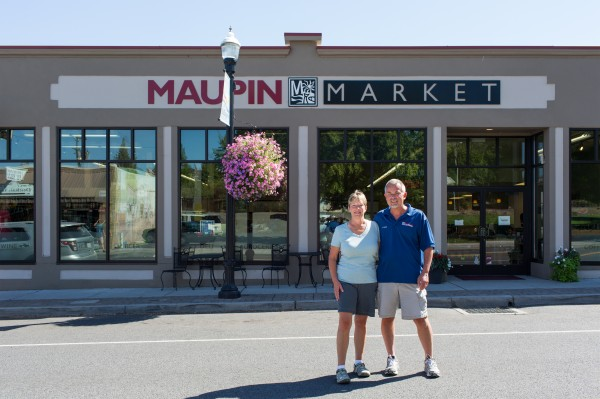 Maupin Market with couple standing in front